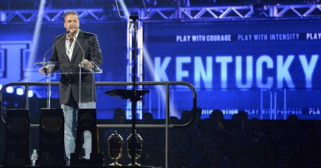 Kentucky men's coach John Calipari speaks to the audience at the NCAA college basketball team's Big Blue Madness, Friday, Oct. 18, 2013, in Lexington, Ky. (AP Photo/Timothy D. Easley)