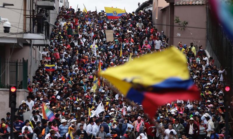 Anti-government demonstrators march in Quito, Ecuador, on 9 October.