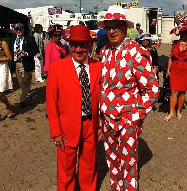 Spectators wearing red suits at the 138th Kentucky Derby horse race at Churchill Downs Saturday, May 5, 2012, in Louisville, Ky.