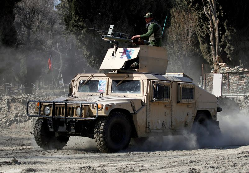FILE PHOTO: An armoured vehicle patrols near the side of an incident where two U.S soldiers were killed a day before in Shirzad district of Nangarhar province