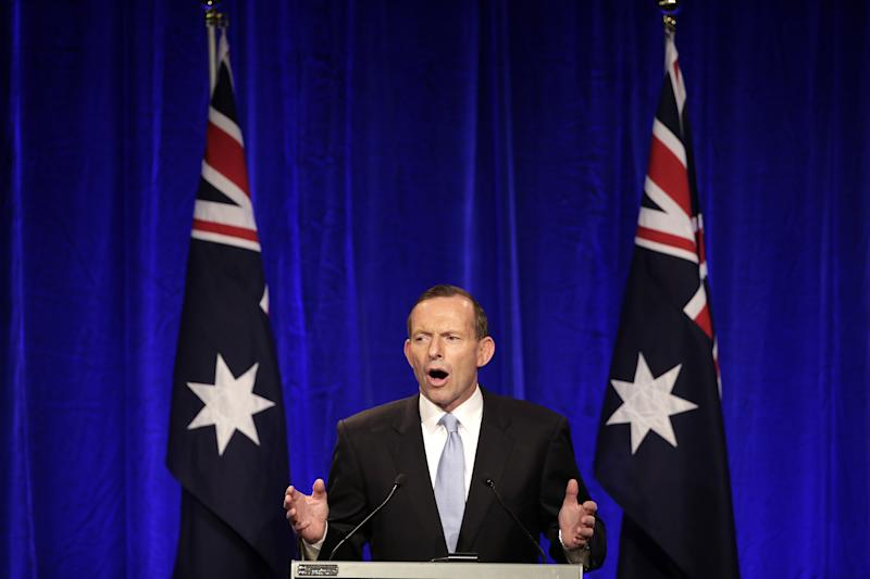 Opposition leader Tony Abbott makes a speech to party supporter in Sydney, Saturday, Sept. 7, 2013, following his party's win in Australia's national election. Australia's conservative opposition swept to power, ending six years of Labor Party rule and winning over a disenchanted public by promising to end a hated tax on carbon emissions, boost a flagging economy and bring about political stability after years of Labor infighting. (AP Photo/Rick Rycroft)