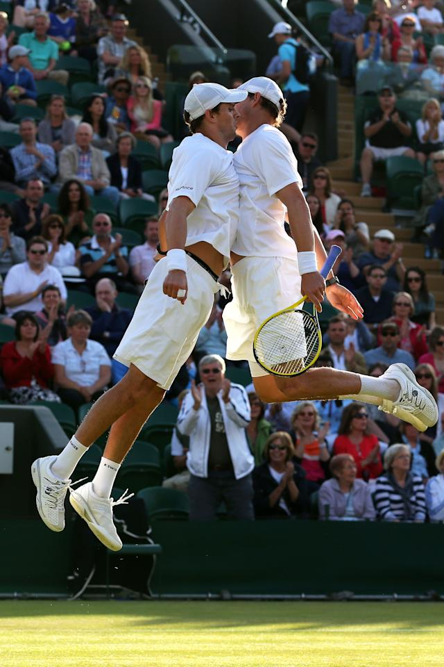 LONDON, ENGLAND - JULY 01: Bob and Mike Bryan bump chests as they celebrate match point during their Gentlemen's Doubles third round match against Treat Huey of Philippines and Dominic Inglot of Great Britain on day seven of the Wimbledon Lawn Tennis Championships at the All England Lawn Tennis and Croquet Club on July 1, 2013 in London, England. (Photo by Julian Finney/Getty Images)
