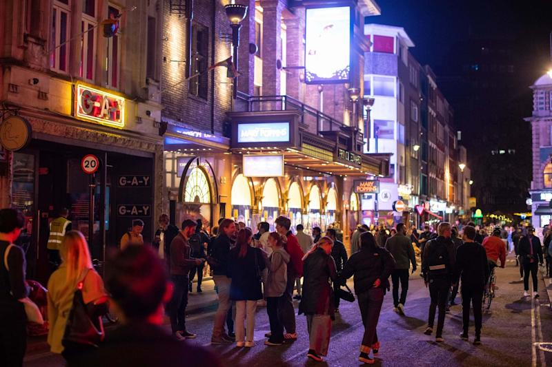 Crowds spilled onto streets in Soho last night (PA)