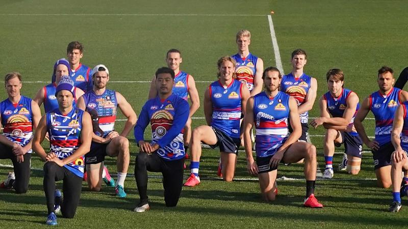 Western Bulldogs players take a knee in solidarity with the Black Lives Matter movement on Thursday
