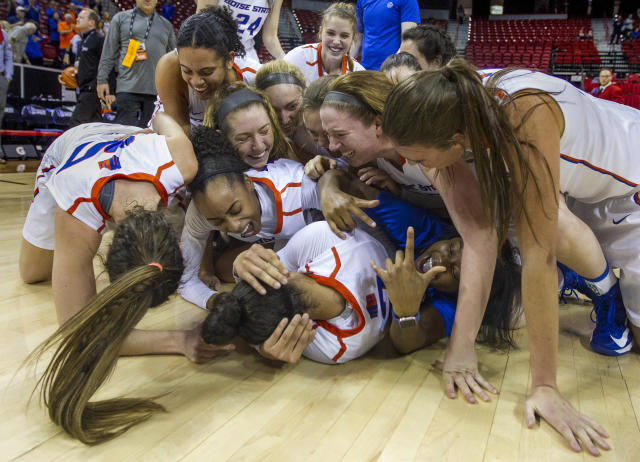 Boise State players pile up on each other in celebration of their win over Nevada during the NCAA college basketball women's championship game in the Mountain West Conference tournament Friday, March 9, 2018, in Las Vegas. (AP Photo/L.E. Baskow)
