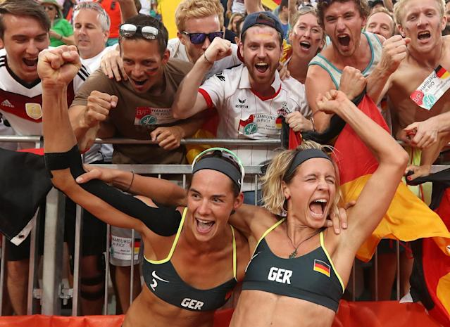 <p>Germany's Laura Ludwig, right, and Kira Walkenhorst, left, celebrate with fans after defeating Brazil in a women's beach volleyball semifinal match at the 2016 Summer Olympics in Rio de Janeiro, Brazil, Tuesday, Aug. 16, 2016. (AP Photo/Petr David Josek) </p>