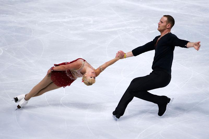 US Caydee Denney and John Coughlin perform during the figure skating event at the 2013 Eric Bompard trophy on November 15, 2013 at the Bercy Palais-Omnisport (POPB) in Paris. AFP PHOTO / KENZO TRIBOUILLARD (Photo credit should read KENZO TRIBOUILLARD/AFP/Getty Images)