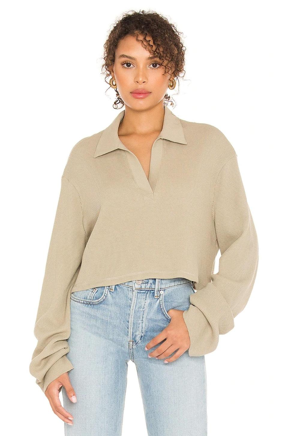 """If you're deep into the polo trend, you'll love this version from The Range. The waffle-knit texture is super-cozy, and the exaggerated sleeves will keep your hands warm as you sip a maple latte outside your neighborhood café. $155, Revolve. <a href=""""https://www.revolve.com/the-range-cropped-polo/dp/THRA-WS82/"""" rel=""""nofollow noopener"""" target=""""_blank"""" data-ylk=""""slk:Get it now!"""" class=""""link rapid-noclick-resp"""">Get it now!</a>"""