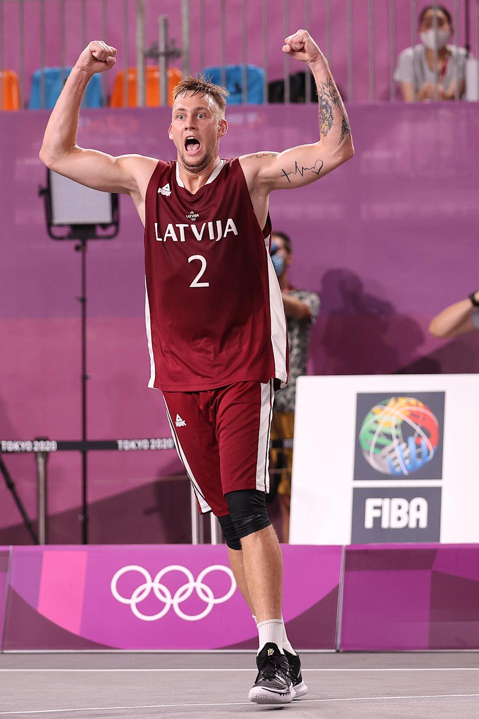 <p>TOKYO, JAPAN - JULY 28: Karlis Lasmanis of Team Latvia celebrates victory and winning the gold medal in the 3x3 Basketball competition on day five of the Tokyo 2020 Olympic Games at Aomi Urban Sports Park on July 28, 2021 in Tokyo, Japan. (Photo by Christian Petersen/Getty Images)</p>