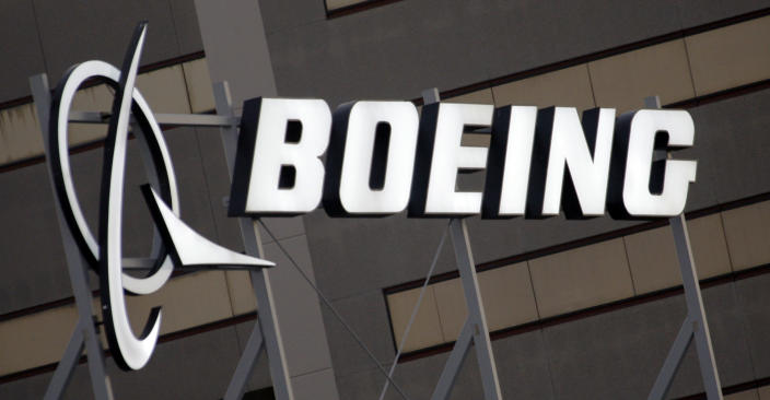 FILE - In this Jan. 25, 2011, file photo, is the Boeing Company logo on the property in El Segundo, Calif. China's government said Monday, Oct. 26, 2020, it will impose sanctions on U.S. military contractors including Boeing Co.'s defense unit and Lockheed Martin Corp. for supplying weapons to rival Taiwan, stepping up a feud with Washington over security and Beijing's strategic ambitions. (AP Photo/Reed Saxon, File)