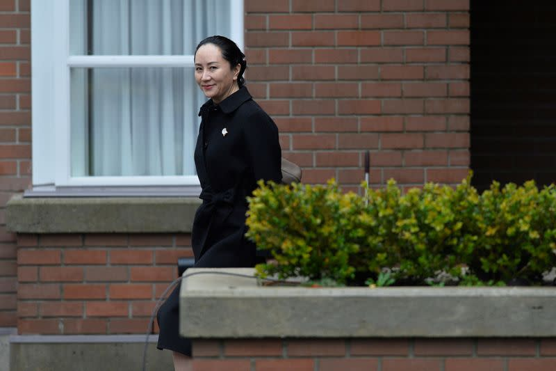 Huawei CFO Meng leaves her home to attend her extradition hearing in Vancouver