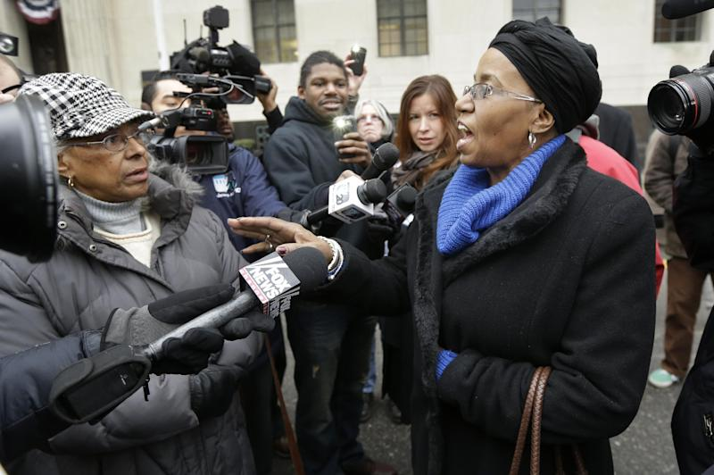 Retiree Cecily McClellan talks to the media outside the federal courthouse in Detroit, Tuesday, Dec. 3, 2013, after Judge Steven Rhodes ruled on the city's bankruptcy filing. Judge Rhodes turned down objections from unions, pension funds and retirees, which, like other creditors, could lose under any plan to solve $18 billion in long-term liabilities. (AP Photo/Carlos Osorio)