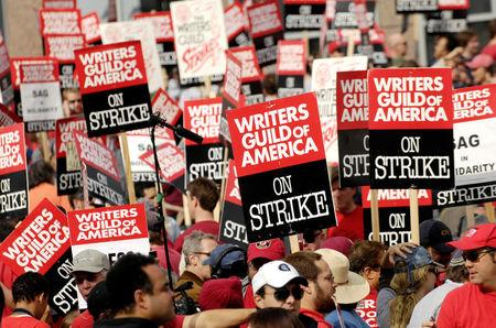 FILE PHOTO: Thousands of Writers Guild of America members and supporters hold signs during a large strike outside the Fox studio lot along the Avenue of the Stars in Los Angeles, California, U.S., on November 9, 2007. REUTERS/Chris Pizzello/File Photo