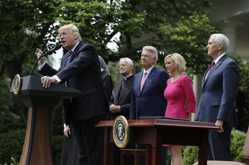 President Trump speaks before signing the executive order on religious liberty, accompanied by Cardinal Donald Wuerl, Pastor Jack Graham, Pastor and televangelist Paula White, and Vice President Mike Pence.