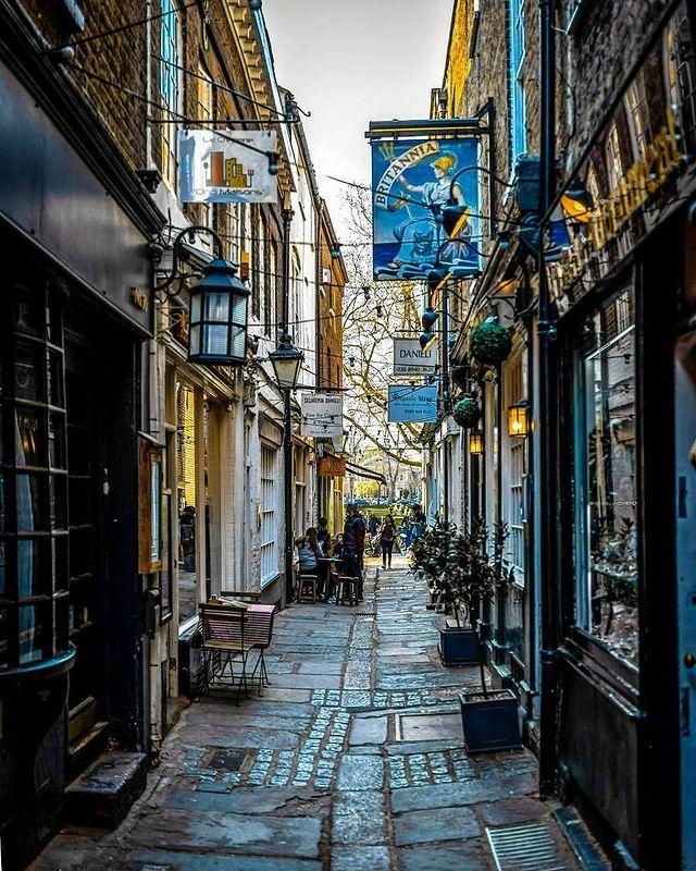 """<p>Richmond's bustling high street is fully of quirky little lanes leading down to Richmond Green, where you'll find some chic independent boutiques, buzzing cafes and impossibly pretty architecture.</p><p>One of our favourites is Brewers Lane, a cute little pedestrian alley that's especially magical at night and during winter, when it's lit by lanterns all the way down to the green. </p><p>Stop off for authentic ice cream at Gelateria Danieli, browse the jewellery at Eastern Adornments or pop into The Britannia for a cosy pint.</p><p><a href=""""https://www.instagram.com/p/Bv93HuBDUxO/"""" rel=""""nofollow noopener"""" target=""""_blank"""" data-ylk=""""slk:See the original post on Instagram"""" class=""""link rapid-noclick-resp"""">See the original post on Instagram</a></p>"""