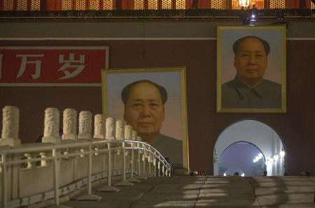 The old portrait of China's late Chairman Mao is removed from Tiananmen Gate to make way for a new one during annual renovation works before the country's 64th national day on October 1, in the early morning in Beijing