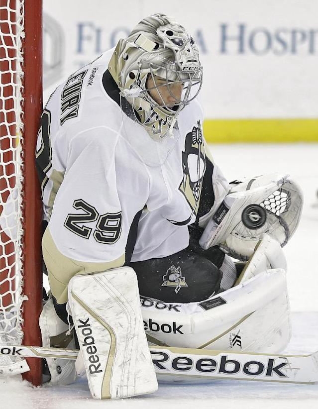 Pittsburgh Penguins goalie Marc-Andre Fleury (29) makes a save on a shot by the Tampa Bay Lightning during the second period of an NHL hockey game on Friday, Nov. 29, 2013, in Tampa, Fla. (AP Photo/Chris O'Meara)