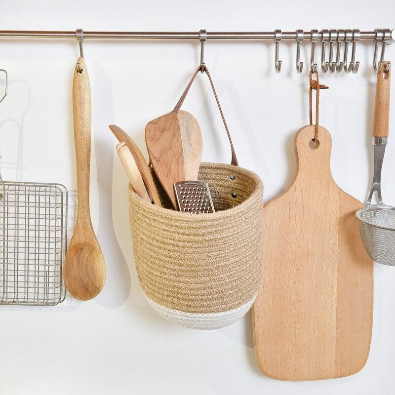 """<h2>43% Hanging Basket</h2><br><strong>43 reviews and 4.7 out of 5 stars</strong><br>""""Well made and ridiculously cute. Living in a small space means being creative with storage, and this fits the bill!""""<br><br><em>Shop <strong><a href=""""https://www.wayfair.com/storage-organization/pdp/dovecove-hanging-basket-w004281904.html?piid=1648163511"""" rel=""""nofollow noopener"""" target=""""_blank"""" data-ylk=""""slk:Wayfair"""" class=""""link rapid-noclick-resp"""">Wayfair</a></strong></em><br><br><strong>Dovecove</strong> Hanging Basket, $, available at <a href=""""https://go.skimresources.com/?id=30283X879131&url=https%3A%2F%2Fwww.wayfair.com%2Fstorage-organization%2Fpdp%2Fdovecove-hanging-basket-w004281904.html%3F"""" rel=""""nofollow noopener"""" target=""""_blank"""" data-ylk=""""slk:Wayfair"""" class=""""link rapid-noclick-resp"""">Wayfair</a>"""