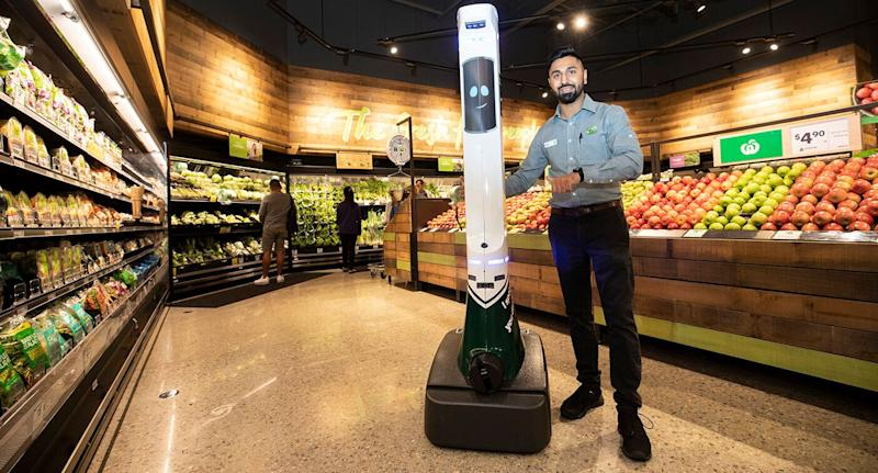 Woolworths staff member poses with the safety robot at the Gregory Hills store.