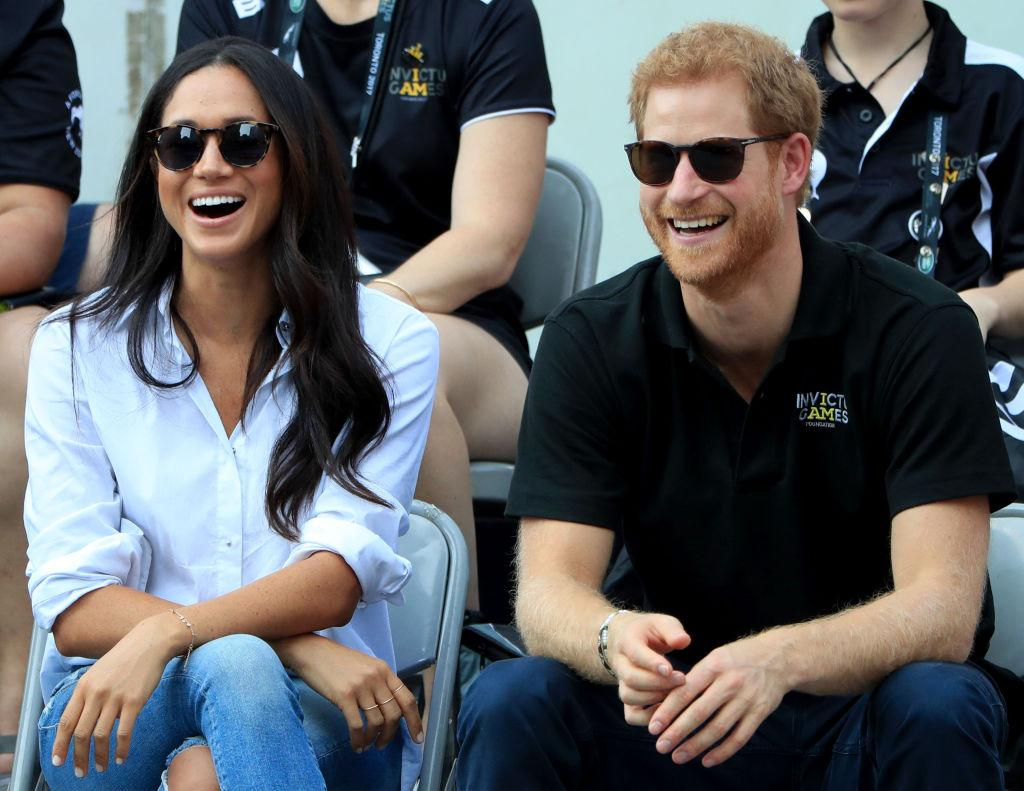"<p>At the same Invictus Games, Meghan sat relaxed with her legs crossed as she watched the event with her then boyfriend, Harry. No biggy for the rest of us, but according to Beaumont Etiquette, the royal-in-waiting should never cross her legs at the knee. Instead, she should keep her ankles and knees together at all times and either cross at the ankle or do the ""Duchess Slant"". The famous etiquette term used to describe the way the Duchess of Cambridge and Princess Diana were taught to sit. <em>[Photo: Getty]</em> </p>"