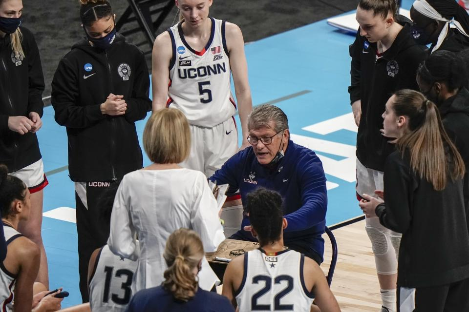 UConn head coach Geno Auriemma talks to his players during the first half of an NCAA college basketball game against Iowa in the Sweet 16 round of the Women's NCAA tournament Saturday, March 27, 2021, at the Alamodome in San Antonio. (AP Photo/Morry Gash)