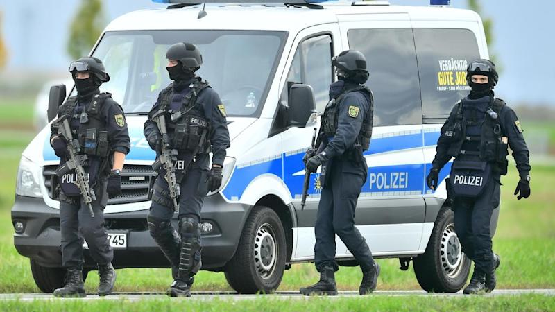 Residents in the German city of Halle were told to stay indoors after two people were killed