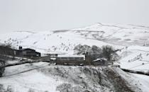 Snow surrounds a farm in Little Hayfield in the Peak District National Park, in Derbyshire,. Picture date: Sunday January 24, 2021. (Photo by Danny Lawson/PA Images via Getty Images)