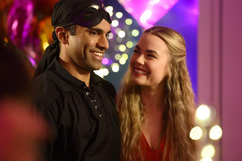 Kash (Nikesh Patel) with his fiancé Ainsley (Rebecca Rittenhouse)