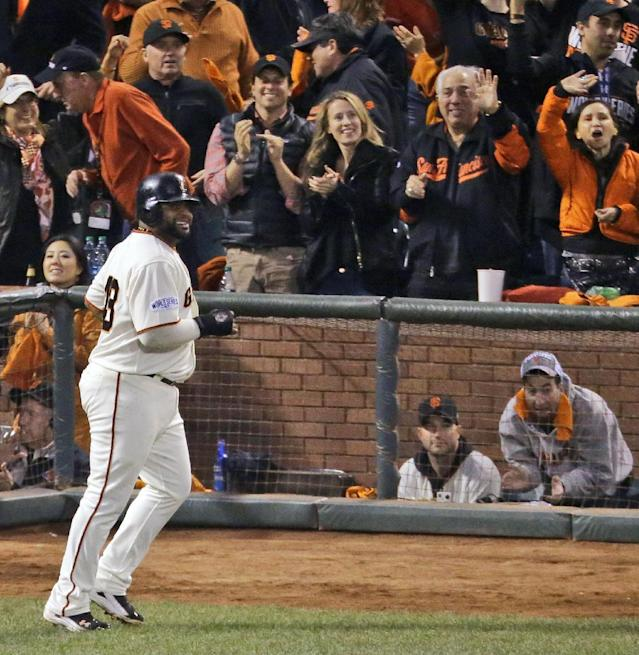 San Francisco Giants' Pablo Sandoval smiles after scoring on an RBI single by Brandon Crawford during the fourth inning of Game 5 of baseball's World Series against the Kansas City Royals on Sunday, Oct. 26, 2014, in San Francisco. (AP Photo/Charlie Riedel)