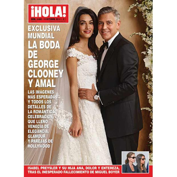 Amal and George on the cover of HELLO! Magazine. She is wearing a gown by Oscar de la Renta.