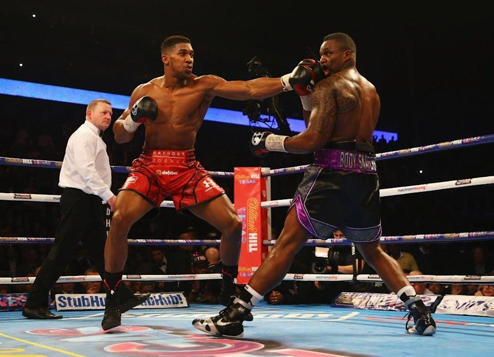 Dillian Whyte (right) has predicted that Anthony Joshua will stop Oleksandr Usyk  (Getty Images)