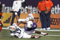 Auburn defensive back Marco Domio, left, tackles Northwestern wide receiver Bryce Kirtz after a reception during the first half of the Citrus Bowl NCAA college football game, Friday, Jan. 1, 2021, in Orlando, Fla. (AP Photo/John Raoux)