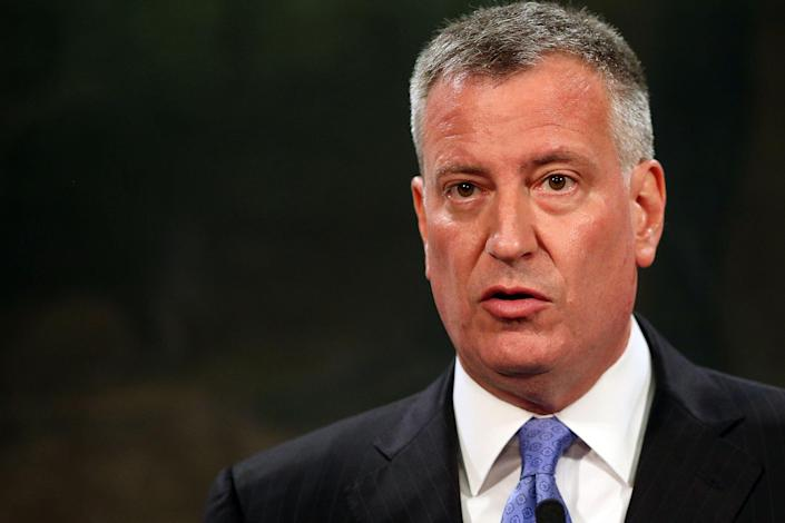 New York Mayor Bill de Blasio speaks to the media at a news conference to address the recent death of a man in police custody on July 18, 2014 in New York City (AFP Photo/Spencer Platt)