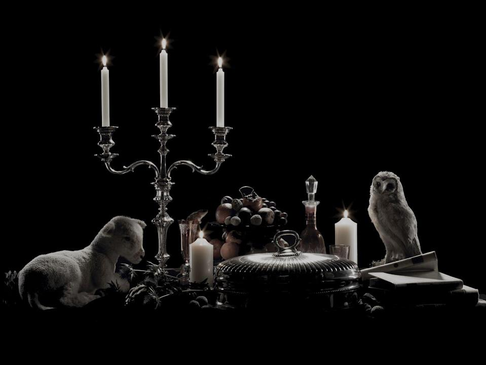 """<p>Invite your bravest friends for a frightening, adults-only dinner party. For the most spooktacular setting, decorate your dining room table with black linens, dishes, utensils, serving pieces, and candleholders, as well as few creepy curiosities, like your child's stuffed animals and passed-down antique tchotchkes. Then to make things even eerier, serve and eat your scary dinner—<a href=""""https://www.oprahmag.com/life/food/g28099287/fall-cocktails/?slide=30"""" rel=""""nofollow noopener"""" target=""""_blank"""" data-ylk=""""slk:vampire cocktails"""" class=""""link rapid-noclick-resp"""">vampire cocktails</a>, mummy baked brie, eyeball pasta, bloody cheesecake—entirely by candlelight.<br></p>"""