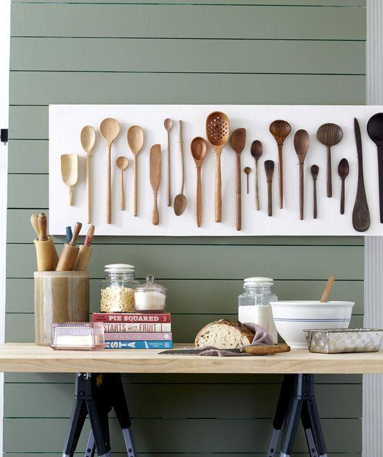 <p>Wooden spoons come in many sizes, shapes, and colors, making them the perfect ombre kitchen art. To assemble, cut a piece of plywood to the desired size and paint. Lay spoons in a light-to-dark pattern on the wood, and use a pencil to mark a spot on both sides of each spoon, typically just below the bowl. Remove spoons, and drill holes at markings. Working with one spoon at a time, loop fine-gauge wire over the handle and through the holes; twist together wire ends behind the wood to secure. Repeat until complete, then hang. </p>