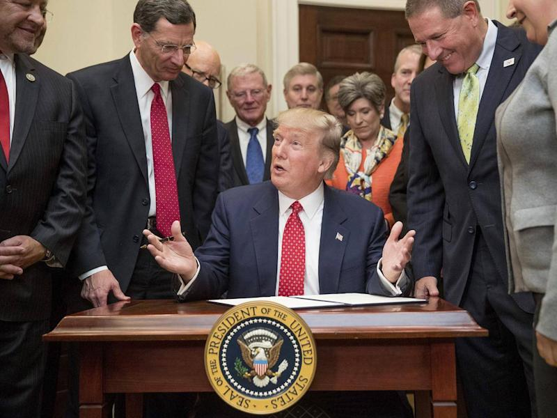 President Donald Trump speaks as he signs an order withdrawing the Waters of the United States (WOTUS) rule, 28 February 2017 (AP)