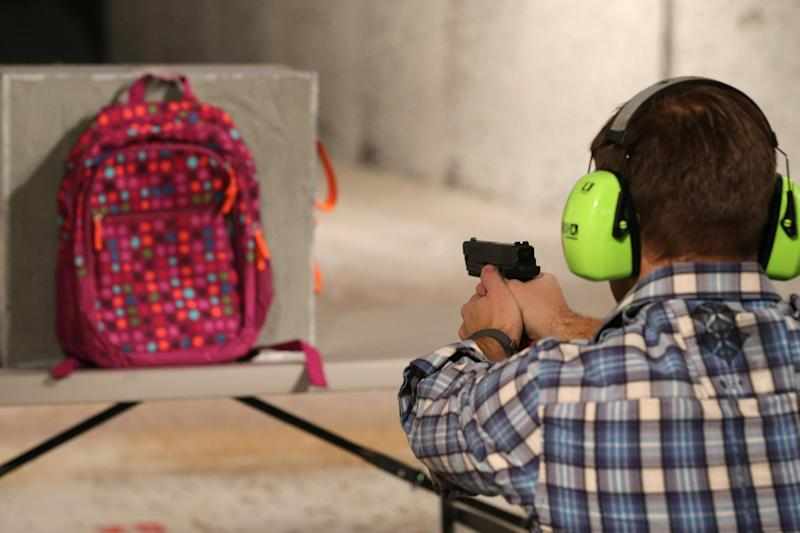 A man shoots at a backpack fitted with a similar bulletproof shield: Getty Images