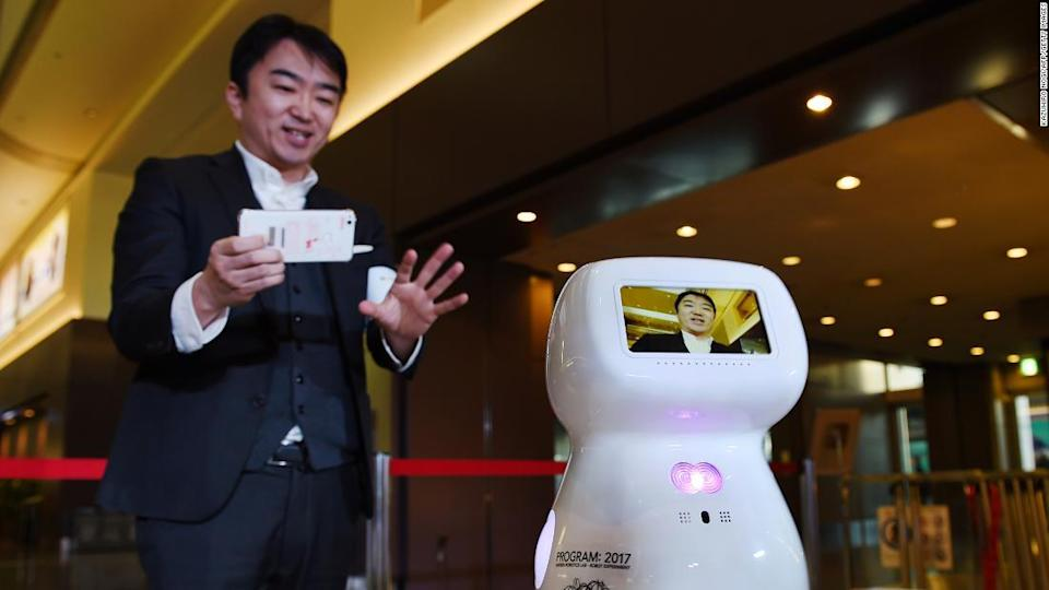 """<p>Donut Robotics CEO Taisuke Ono tests out the communication robot prototype, Cinnamon, at Tokyo's Haneda Airport in 2017.</p><div class=""""cnn--image__credit""""><em><small>Credit: Kazuhiro Nogi/AFP/Getty Images / Getty</small></em></div>"""