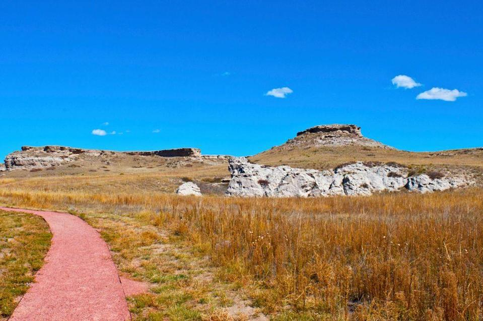 """<p><a href=""""https://www.nps.gov/agfo/index.htm"""" rel=""""nofollow noopener"""" target=""""_blank"""" data-ylk=""""slk:Agate Fossil Beds National Monument"""" class=""""link rapid-noclick-resp""""><strong>Agate Fossil Beds National Monument</strong></a></p><p>A lot of Nebraska is filled with farmland, but this open space makes it the perfect place for wild animals to roam. Find out why paleontologists love this fossil filled spot. </p>"""
