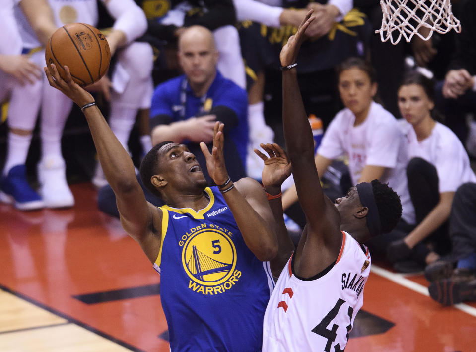 Golden State Warriors centre Kevon Looney (5) drives to the net against Toronto Raptors forward Pascal Siakam (43) during first half basketball action in Game 1 of the NBA Finals in Toronto on Thursday, May 30, 2019. (Nathan Denette/The Canadian Press via AP)