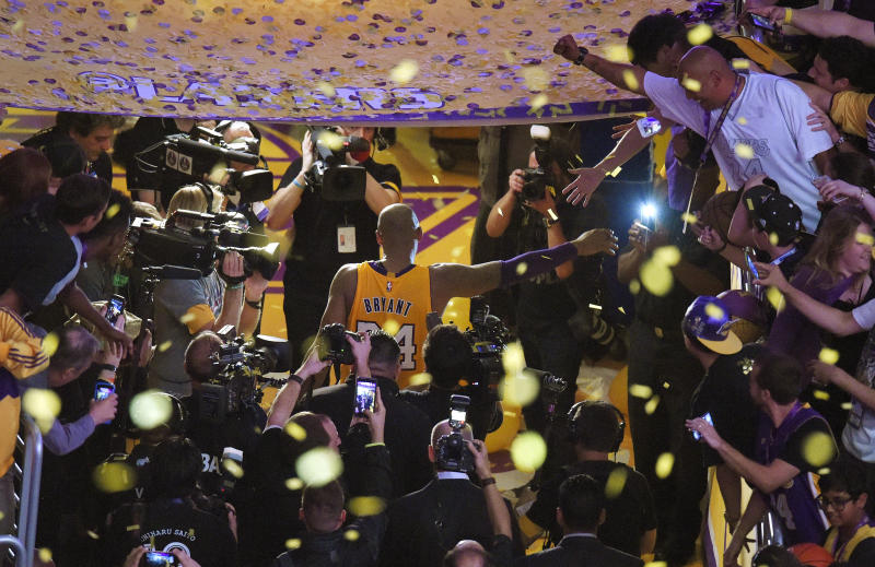 FILE - In this April 13, 2016, file photo, Los Angeles Lakers forward Kobe Bryant walks off the court after finishing his last NBA basketball game before retirement in Los Angeles. Bryant, the 18-time NBA All-Star who won five championships and became one of the greatest basketball players of his generation during a 20-year career with the Los Angeles Lakers, died in a helicopter crash Sunday, Jan. 26, 2020. (AP Photo/Mark J. Terrill, File)