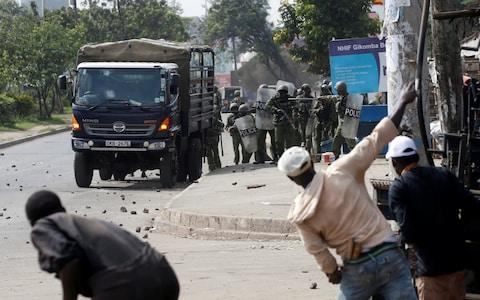 Supporters of Kenyan opposition National Super Alliance (NASA) coalition throw stones at police in Nairobi - Credit: BAZ RATNER/Reuters
