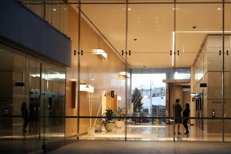 FILE PHOTO: People are seen on the ground floor of an office building in Sydney