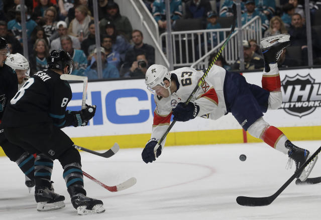 Florida Panthers right wing Evgenii Dadonov (63) falls in front of San Jose Sharks center Joe Pavelski (8) during the second period of an NHL hockey game in San Jose, Calif., Thursday, March 14, 2019. (AP Photo/Jeff Chiu)