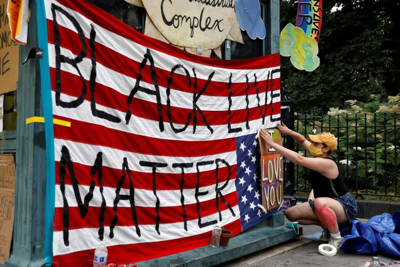 """FILE PHOTO: """"Defund the Police"""" protests at the City Hall Autonomous Zone near City Hall in Manhattan, New York City"""