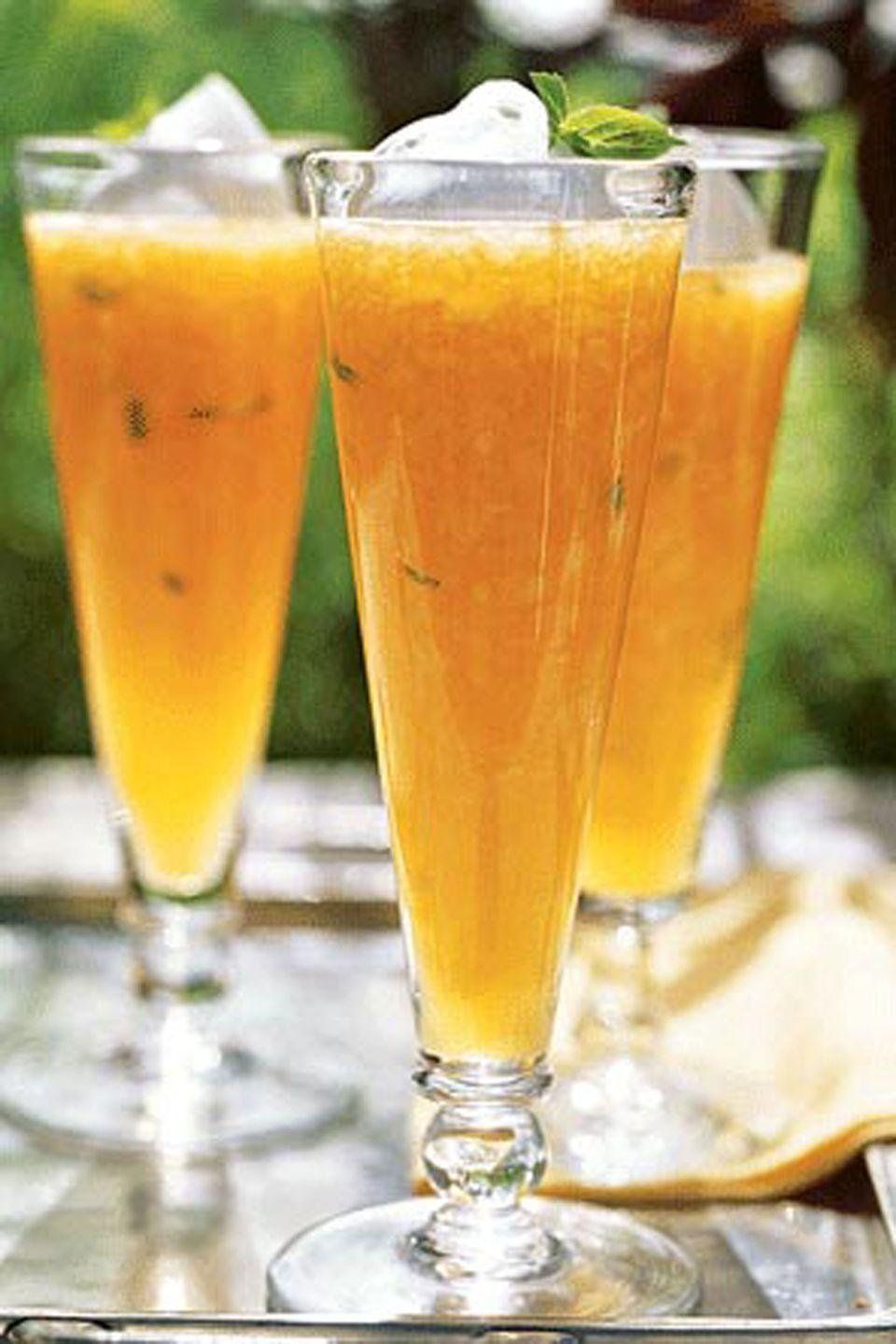 """<p>Our refreshing cantaloupe soup, inspired by chef Shawn Lawson, is a cool menu change. Instead of using traditional soup plates, try a mix of pilsner glasses and champagne flutes.</p><p><strong><a href=""""https://www.countryliving.com/food-drinks/recipes/a1130/cantaloupe-soup-basil-cream-3237/"""" rel=""""nofollow noopener"""" target=""""_blank"""" data-ylk=""""slk:Get the recipe"""" class=""""link rapid-noclick-resp"""">Get the recipe</a>.</strong></p><p><a class=""""link rapid-noclick-resp"""" href=""""https://www.amazon.com/Cuisinart-DFP-14CPYAMZ-Food-Processor/dp/B07XJ8FCXH?tag=syn-yahoo-20&ascsubtag=%5Bartid%7C10050.g.850%5Bsrc%7Cyahoo-us"""" rel=""""nofollow noopener"""" target=""""_blank"""" data-ylk=""""slk:SHOP FOOD PROCESSORS"""">SHOP FOOD PROCESSORS</a></p>"""