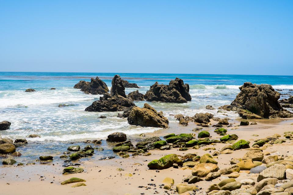 <p><strong>Give us the wide-angle view: what kind of beach are we talking about?</strong><br> This lesser-known Malibu beach has similarly gorgeous rock formations to the ones you'd find at El Matador, but is far less crowded—so much less crowded it could practically be considered private.</p> <p><strong>How accessible is it?</strong><br> You can find access via the cul-de-sac at Bunnie Lane, where you'll enter through a tree-covered corridor and need to go down a few flights of stairs.</p> <p><strong>Decent services and facilities, would you say?</strong><br> As it's secluded, there are no services available, so pack in what you'll need for the day.</p> <p><strong>How's the actual beach stuff—sand and surf?</strong><br> The tide pooling is fantastic, but the beach is still sandy if you want to spread out.</p> <p><strong>Can we go barefoot?</strong><br> You'll want to start with sandals, at least until you get situated, because of the rocks.</p>
