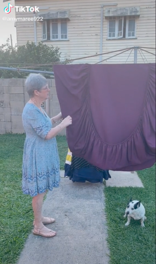 Woman folding a fitted sheet