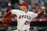 Los Angeles Angels starting pitcher Andrew Heaney throws to a Cincinnati Reds batter during the first inning of a baseball game in Anaheim, Calif., Tuesday, June 25, 2019. (AP Photo/Chris Carlson)
