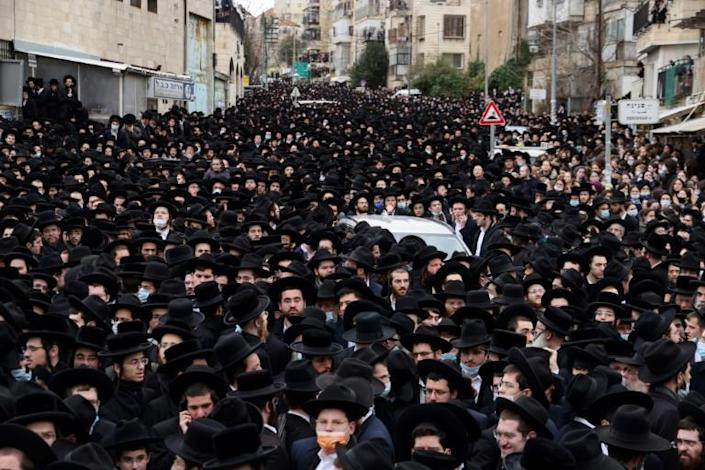Thousands of ultra-Orthodox Jews flagrantly defied Israel's lockdown to attend a rabbi's funeral in Jerusalem